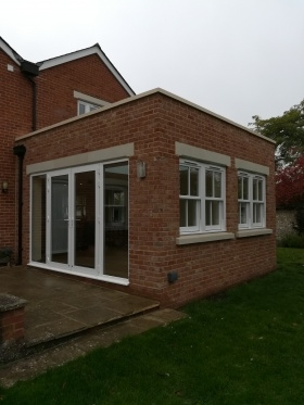 White Alitherm Orangery with upvc Vertical sliders
